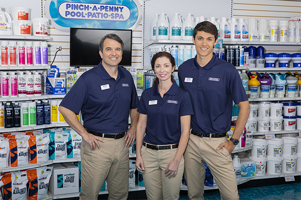 three employees in front of products