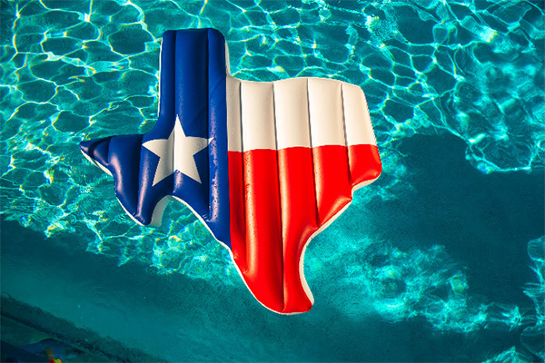 inflated texas shaped pool toy in pool