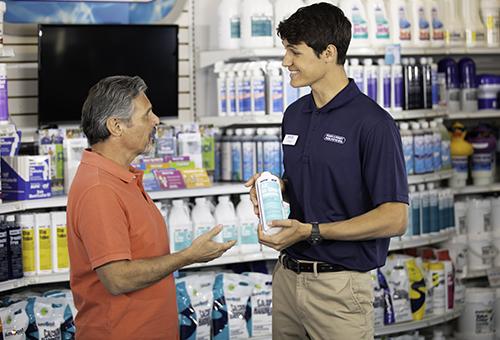 Pinch A Penny associate helping a customer.